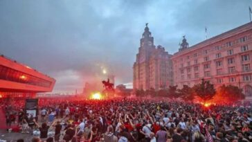 Liverpool fans let off flares outside the Liver Building in Liverpool, Friday June 26, 2020, as Liverpool soccer fans gather and celebrate for the team clinched the English Premier League title.