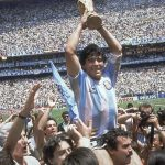 In this June 29, 1986 file photo, Diego Maradona holds up his team