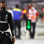 BAHRAIN, BAHRAIN - NOVEMBER 29: Lewis Hamilton of Great Britain and Mercedes GP walks in the Pitlane during the red flag delay during the F1 Grand Prix of Bahrain at Bahrain International Circuit on November 29, 2020 in Bahrain, Bahrain. (Photo by Mark Thompson/Getty Images)